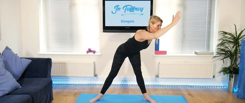 A photo showing a pilates class to improve posture through stretching